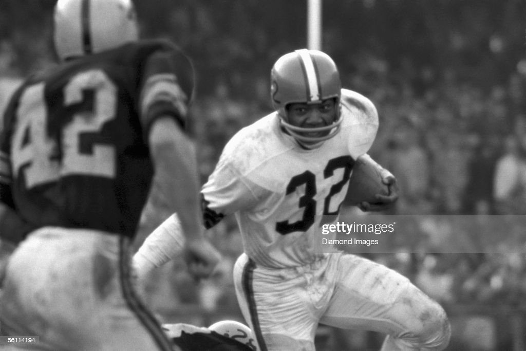 Runningback Jim Brown #32, of the Cleveland Browns, shakes the tackle of George Volkert #28, of the Pittsburgh Steelers, as Dick Alban #42 comes up to try to make the tackle during a game on October 19, 1958 at Municipal Stadium in Cleveland, Ohio.