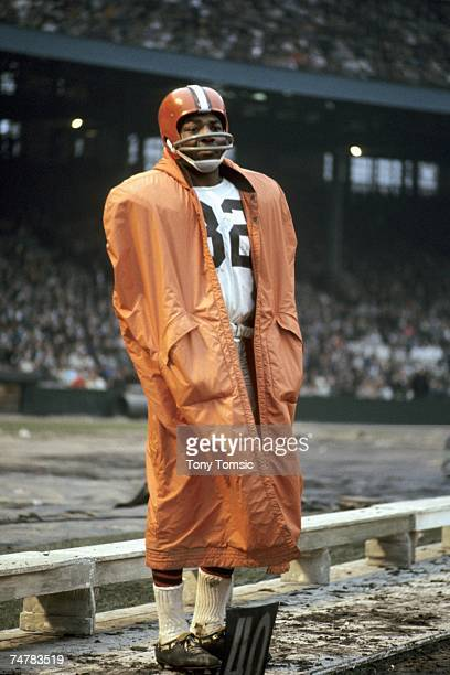 Runningback Jim Brown of the Cleveland Browns watches the action from the sidelines during a game on December 5 1965 against the Washington Redskins...