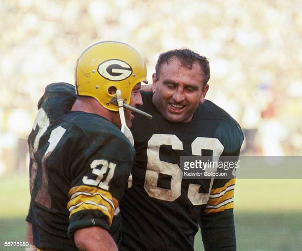Runningback Jim Taylor of the Green Bay Packers gets a hug from teammate Fred Fuzzy Thurston after Taylor's 14yard touchdown run put the Packers...