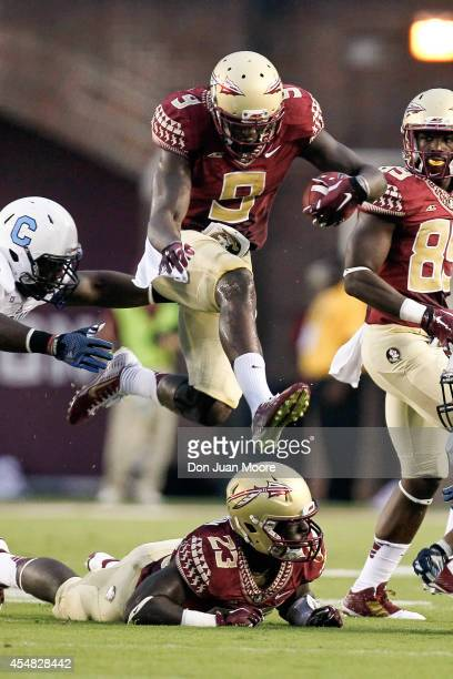 Runningback Karlos Williams of the Florida State Seminoles leaps over teammate Runningback Freddie Stevenson during the game against the Citadel...