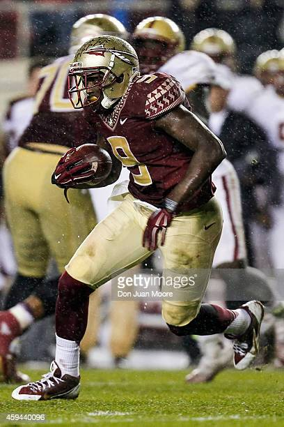Runningback Karlos Williams of the Florida State Seminoles on a running play during the game against the Boston College Eagles at Doak Campbell...