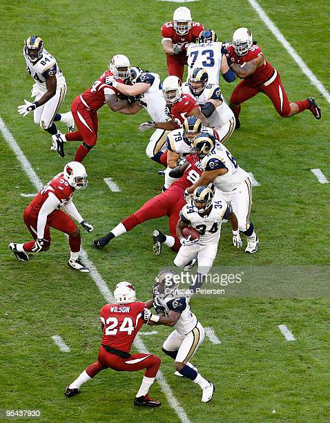 Runningback Kenneth Darby of the St Louis Rams rushes the ball against Chike Okeafor and the Arizona Cardinals during the first quarter of the NFL...