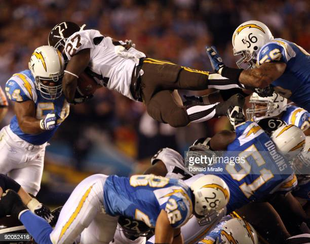 Runningback Knowshon Moreno of the Denver Broncos goes up for the first down against the San Diego Chargers during Monday Night Football on October...