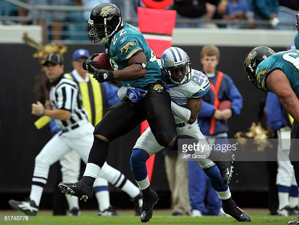 Runningback LaBrandon Toefield of the Jacksonville Jaguars runs past Fernando Bryant of the Detroit Lions for a touchdown in the first half at Alltel...