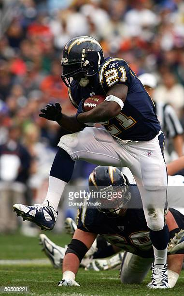 Runningback LaDainian Tomlinson of the San Diego Chargers runs against the defense of the Denver Broncos during the 1st half of their NFL Game on...