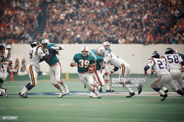 Runningback Larry Csonka of the Miami Dolphins breaks free on a long run during Super Bowl VIII on January 13 1974 against the Minnesota Vikings at...
