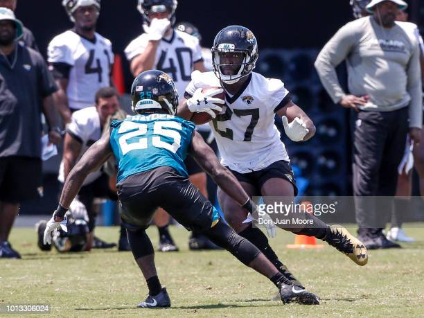 Runningback Leonard Fournette goes one on one with Cornerback DJ Hayden of the Jacksonville Jaguars during Training Camp at Dream Finders Homes...
