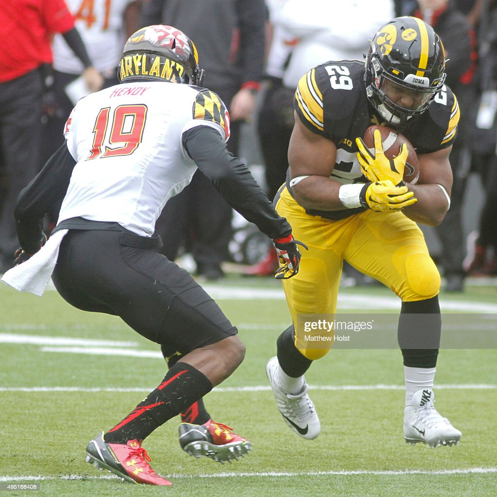 Runningback LeShun Daniels #29 of the Iowa Hawkeyes runs up the field in front of defensive back A.J. Hendy #19 of Maryland Terrapins in the second half on October 31, 2015 at Kinnick Stadium, in Iowa City, Iowa.