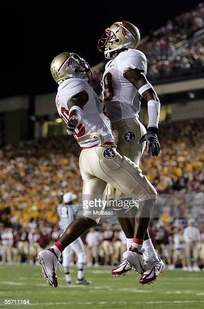 Runningback Lorenzo Booker and wide receiver Greg Carr of the Florida State Seminoles celebrate Carr's touchdown in the secong half against the...