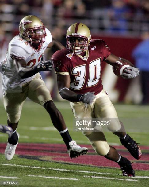 Runningback LV Whitworth of the Boston College Eagles runs the ball against free safety Pat Watkins of the Florida State Seminoles during their...