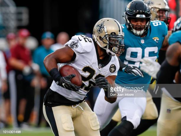 Runningback Mark Ingram II of the New Orleans Saints on a running play during a preseason game against the Jacksonville Jaguars at TIAA Bank Field on...