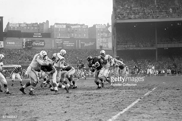 Runningback Mel Triplett of the New York Giants runs the ball during the NFL Championship Game on December 28 1958 against the Baltimore Colts at...