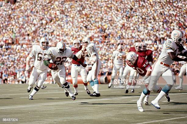 Runningback Mercury Morris of the Miami Dolphins runs the ball during a game against the New England Patriots on November 12 1972 at the Orange Bowl...