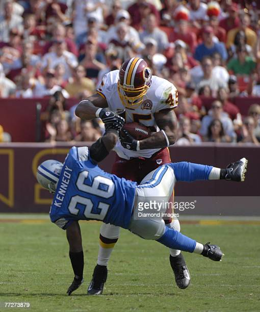 Runningback Mike Sellers of the Washington Redskins runs through the tackle attempt by safety Kenoy Kennedy of the Detroit Lions on a 24 yard pass...