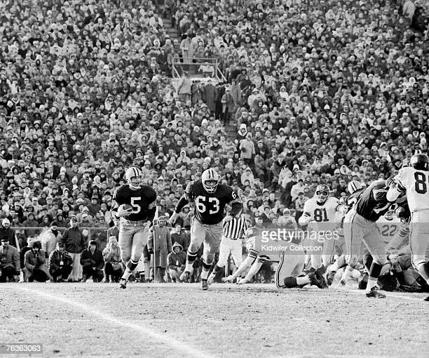 Runningback Paul Hornung of the Green Bay Packers runs with the ball as guard Fuzzy Thurston looks to set a block during the NFL Championship Game on...