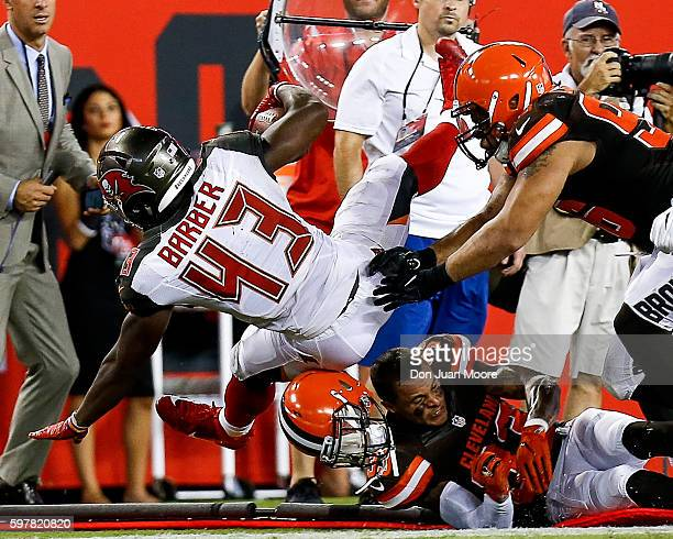 Runningback Peyton Barber of the Tampa Bay Buccaneers is forced out of bounds by Defensive End Xavier Cooper and Safety Jordan Poyer who looses his...