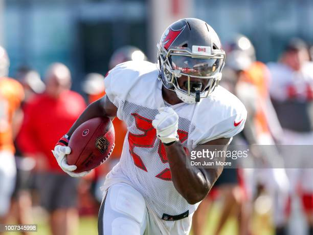 Runningback Peyton Barber of the Tampa Bay Buccaneers on a running play during Training Camp at One Buc Place on July 29 2018 in Tampa Florida
