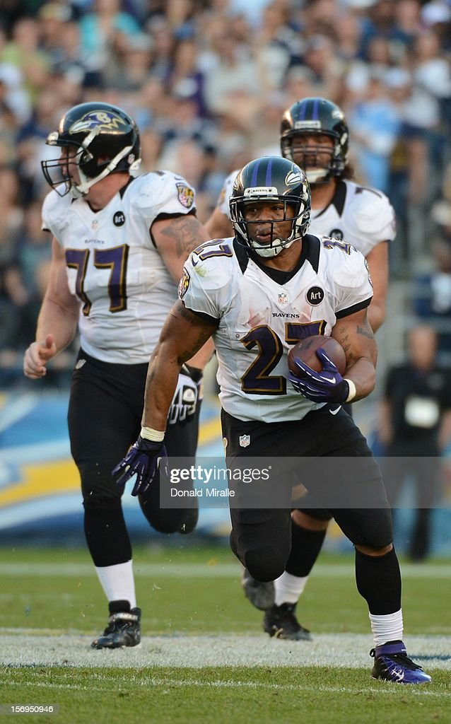 Runningback Ray Rice #27 of the Baltimore Ravens runs for a first down on a 4th and 29 at the end of the 4th quarter en route to his team's 16-13 overtime a win over the San Diego Chargers on November 25, 2012 at Qualcomm Stadium in San Diego, California.
