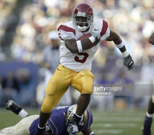Runningback Reggie Bush of the University of Southern California Trojans rushes against the University of Washington Huskies on October 25, 2003 at...