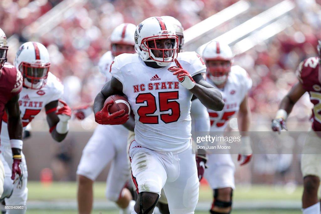 Runningback Reggie Gallaspy II #25 of the North Carolina State Wolfpack on a running play during the game against the Florida State Seminoles at Doak Campbell Stadium on Bobby Bowden Field on September 23, 2017 in Tallahassee, Florida. NC State defeated Florida State 27 to 21.