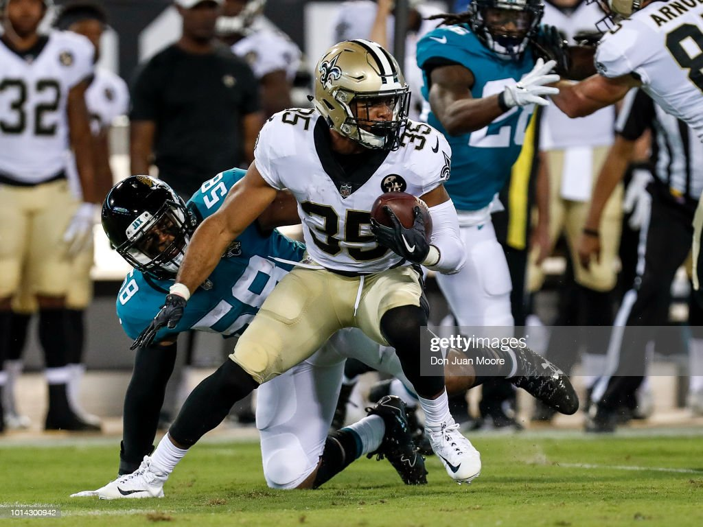 Runningback Shane Vereen #35 of the New Orleans Saints avoids a tackle by Linebacker Deon King #58 of the Jacksonville Jaguars during a preseason game at TIAA Bank Field on August 9, 2018 in Jacksonville, Florida. The Saints defeated the Jaguars 24 to 20.