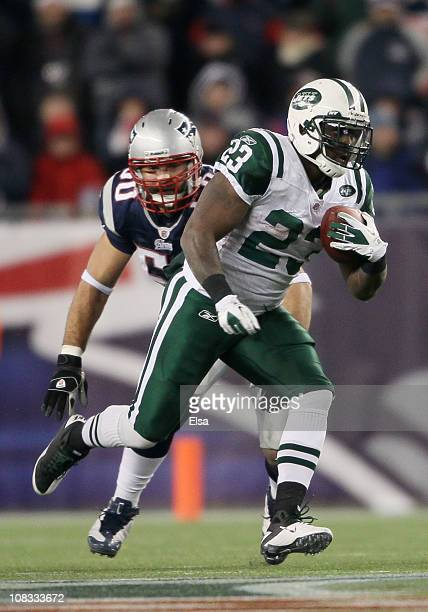 Runningback Shonn Greene of the New York Jets runs with the ball against the New England Patriots during their 2011 AFC divisional playoff game at...