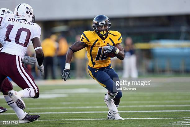 Runningback Steve Slaton of the West Virginia University Mountaineers runs with the ball against the Mississippi State Bulldogs on October 20 2007 at...