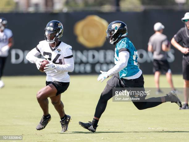 Runningback T J Yeldon is defended by Linebacker Blair Brown of the Jacksonville Jaguars on a running play during Training Camp at Dream Finders...