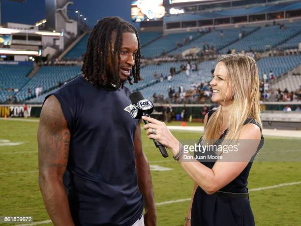 Runningback Todd Gurley II of the Los Angeles Rams talk with Fox Sideline Reporter Shannon Spake after the game against the Jacksonville Jaguars at...