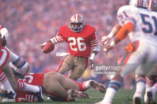 Runningback Wendell Tyler of the Miami Dolphins carries the ball against the San Francisco 49ers during Super Bowl XIX at Stanford Stadium on January...