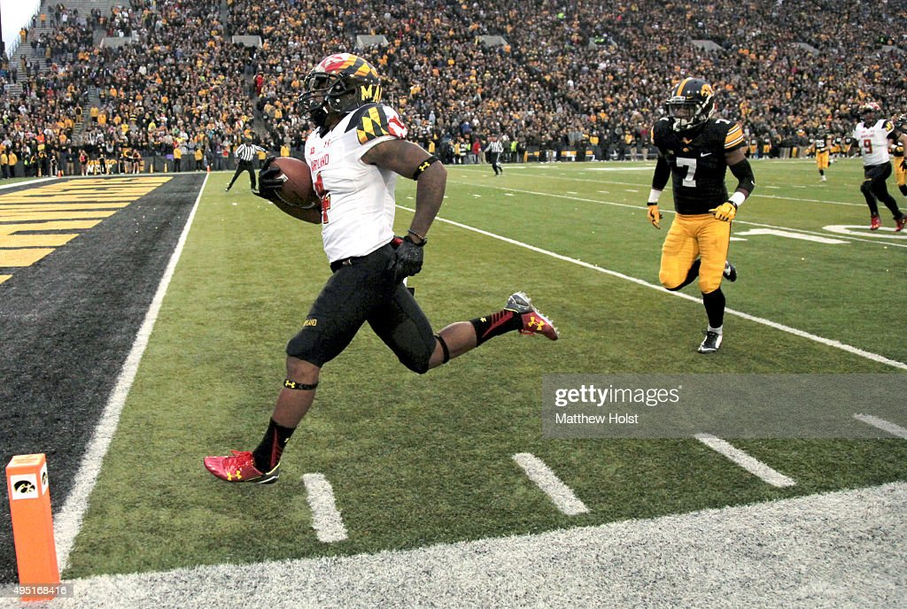 Runningback William Likely #4 of the Maryland Terrapins runs a kickoff back for a touchdown in front of defensive back Sean Draper #7 of the Iowa Hawkeyes in the second half on October 31, 2015 at Kinnick Stadium, in Iowa City, Iowa.