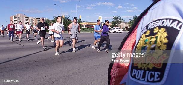 About sixty runners head out on the 10 km Peel Regional Police Run for the Roses that raises money for various charities depending on where the...