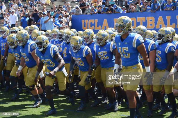 UCLA runs out of the tunnel for the start of the game during a college football game between the Hawai'i Rainbow Warriors and the UCLA Bruins on...