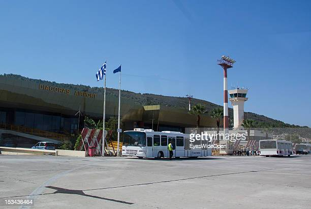 Runway and buses at Diagoras Airport on August 23 2012 in Rhodes Greece Rhodes is the largest of the Greek Dodecanes Islands