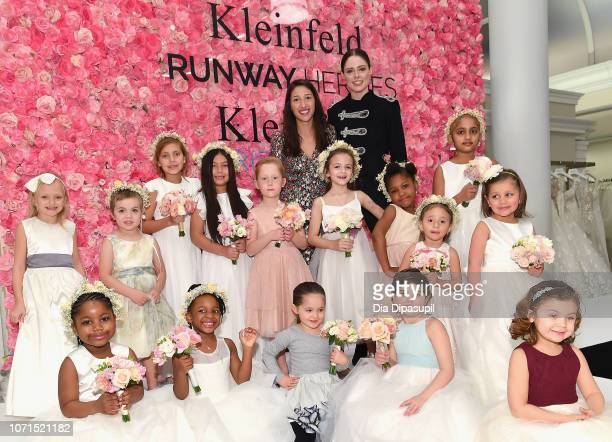 Runway Heroes Founder Rachel Goldman model Coco Rocha Ioni James Conran and cancer fighters and survivors pose onstage during Runway Heroes to...