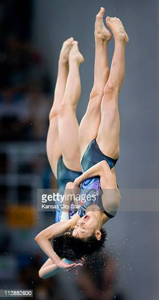 Ruolin Chen front and Xin Wang of China compete in the 10meter Platform Synchronized diving final on Tuesday August 12 in the Games of the XXIX...