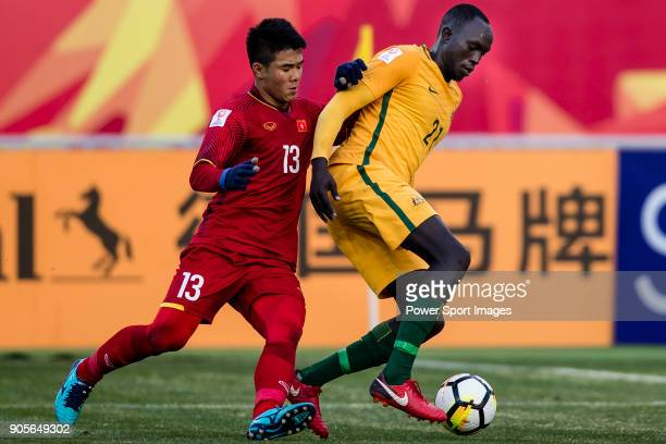 Ruon Tongyik of Australia fights for the ball with Ha Duc Chinh of Vietnam during the AFC U23 Championship China 2018 Group D match between Vietnam...