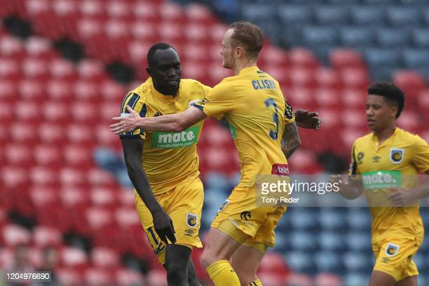 Ruon Tongyik of the Central Coast Mariners celebrates a goal with team mate Jack Clisby during the round 18 ALeague match between the Newcastle Jets...