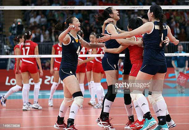 Ruoqi HuiJunjing YangXian Zhang and Yimei Wang of China celebrate the match win over Turkey during Women's Volleyball on Day 3 of the London 2012...