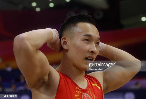 Ruoteng Xiao of China reacts competes after Men's high bar finals during day five of the 2018 FIG Artistic Gymnastics Championships at Aspire Dome on...