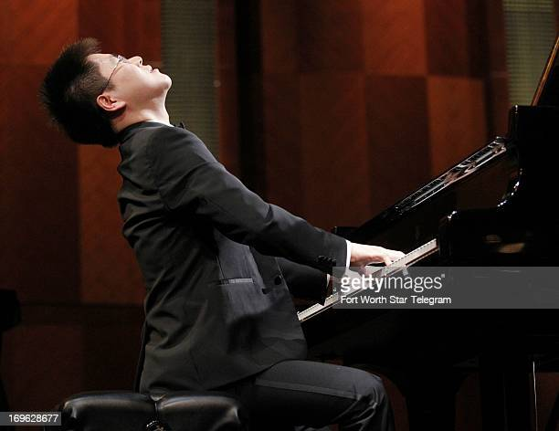 Ruoyu Huang of China performs in the 14th Van Cliburn International Piano Competition at Bass Performance Hall in Fort Worth Texas May 27 2013