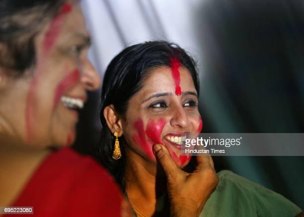 Rupa Maitra play with sindhur during the Sindhur Utsav at The Bengal Club Durga Pandal Shivaji Park
