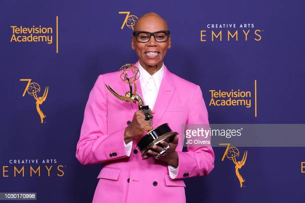 RuPaul Charles, winner of the award for outstanding host for a reality or reality-competition program for 'RuPaul's Drag Race', poses in the press...