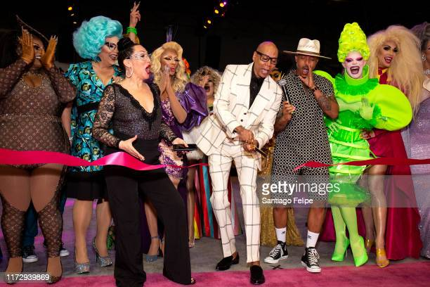 RuPaul cuts the ribbon as Michelle Visage Jamal Sims Mrs Kasha Davis Art SImone Yvie Oddly and Brooke Lynn Hytes look on during RuPaul's DragCon 2019...