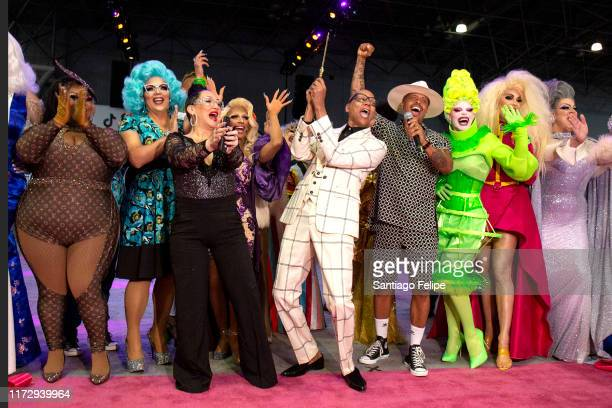 RuPaul cuts the ribbon as Michelle Visage Jamal Sims Mrs Kasha Davis Art SImone Yvie Oddly Brooklyn Hytes and Nina West look on during RuPaul's...