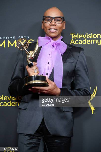 RuPaul poses in the press room with the award for outstanding host for a reality or competition program for 'RuPaul's Drag Race' during the 2019...