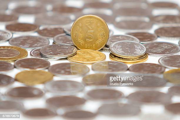 5 rupees indian currency coin over other coins