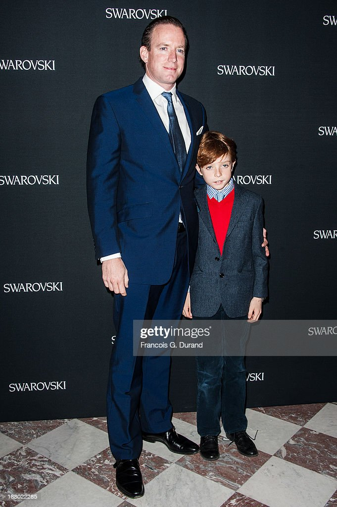 Rupert Adams and his son Rigby attend the Swarovski Dinner In Honor of the Bouroullec Brothers at Chateau de Versailles on November 14, 2013 in Versailles, France.