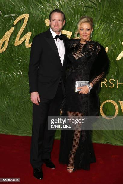 Rupert Adams and Nadja Swarovski pose on the red carpet upon arrival to attend the British Fashion Awards 2017 in London on December 4 2017 / AFP...