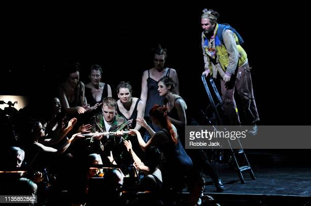 Rupert Charlesworth as Tamino and Thomas Oliemans as Papageno with artists of the company in English National Opera's production of Wolfgang Amadeus...